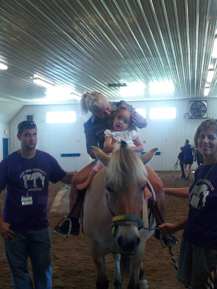 Lilliana horse rides with a therapist